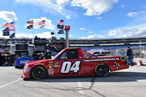 The No. 04 Preferred Industrial Contractors, Inc. Ford F-150 rolls through the garage at Texas Motor Speedway.